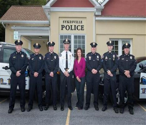 Police officers standing in front of the Sykesville Police Department